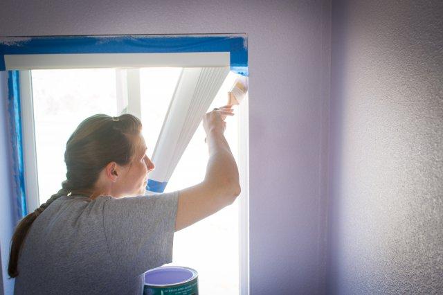woman paiting wall